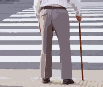 とぼとぼと歩いている老人